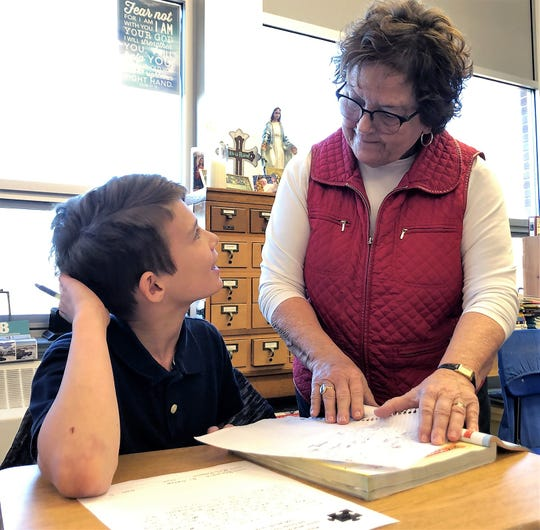 "Joy Padgett talks with Benjamin Druen about his ""What Makes a Dad, Father of the Year?"" essay. The assignment is part of the Coshocton County Fatherhood Initiative, just one of the ways Padgett engages her students."
