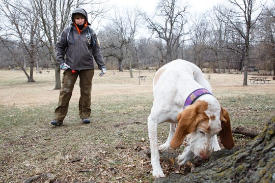 Tammy Hansen works with her dog, Tessa, on a human remains recovery drill at Heritage Park on Wednesday, Nov. 28, 2018, in Ankeny. Patterson is part of a group of women who assist authorities across the country in tracking missing persons.