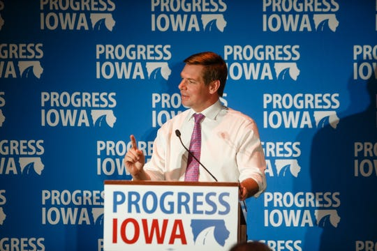 U.S. Rep. and Iowa native Eric Swalwell speaks during Progress Iowa's Holiday Party on Thursday, Dec. 20, 2018, in Des Moines.
