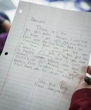 A thank you note from one of the bus riding students to Tub Shine owner Carroll Moore.