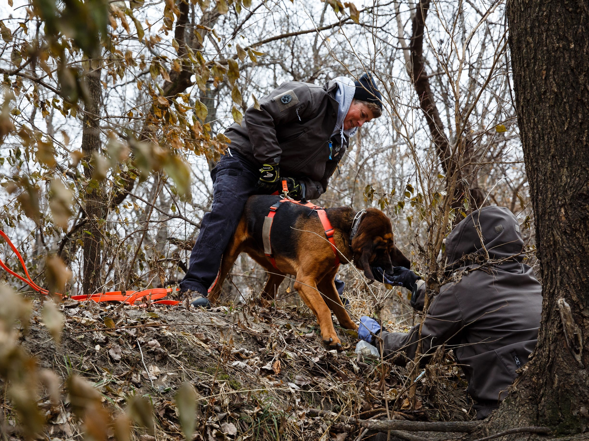 Why a handful of Iowa women volunteer their trained dogs to bring home the missing and the dead