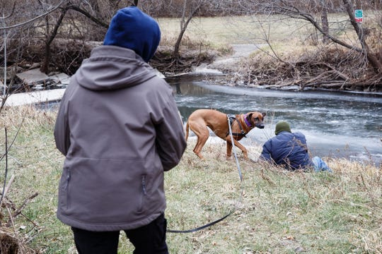 Cheri Sorensen follows her dog, Kimber, during a trailing drill to find Rich Betterley at Heritage Park on Wednesday, Nov. 28, 2018, in Ankeny. Sorensen is part of a group of women who assist authorities across the country in tracking missing persons.