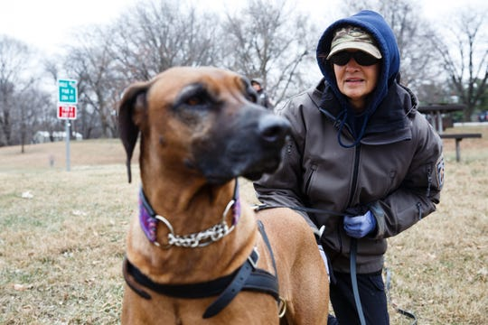Cheri Sorensen readies her dog, Kimber, to work on a trailing drill at Heritage Park on Wednesday, Nov. 28, 2018, in Ankeny. Sorensen is part of a group of women who assist authorities across the country in tracking missing persons.