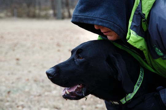 Jenn Hirakawa works with her dog, Moose, on a human remains recovery drill at Heritage Park on Wednesday, Nov. 28, 2018, in Ankeny. Hirakawa is part of a group of women who assist authorities across the country in tracking missing persons.