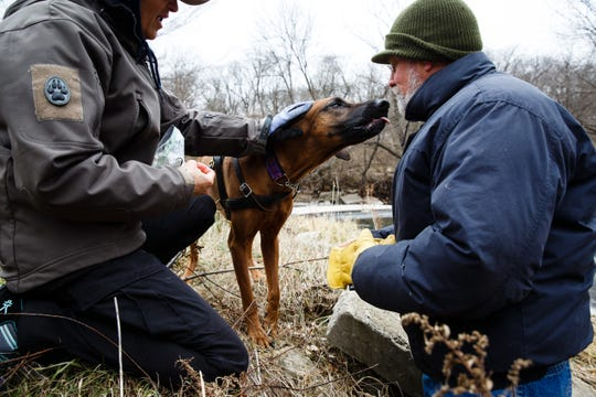 Cheri Sorensen rewards her dog, Kimber, after Kimber found Rich Betterley during a trailing drill at Heritage Park on Wednesday, Nov. 28, 2018, in Ankeny. Sorensen is part of a group of women who assist authorities across the country in tracking missing persons.