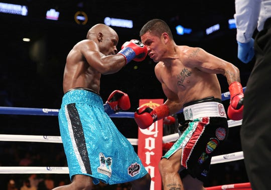 Tony Harrison, left, throws a punch at Paul Valenzuela Jr. during their bout at Barclays Center, Saturday, Oct. 14, 2017, in New York.
