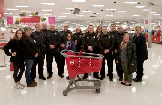 "Police officers from Sylvan Lake, Bloomfield Township, Keego Harbor and Orchard Lake, along with some of their family members, participated in a Dec. 19, 2018 ""Shop with a Cop"" event at the Target on Telegraph in Bloomfield Township. During the event, two women were arrested for trying to steal $1,900 worth of electronics from the store."
