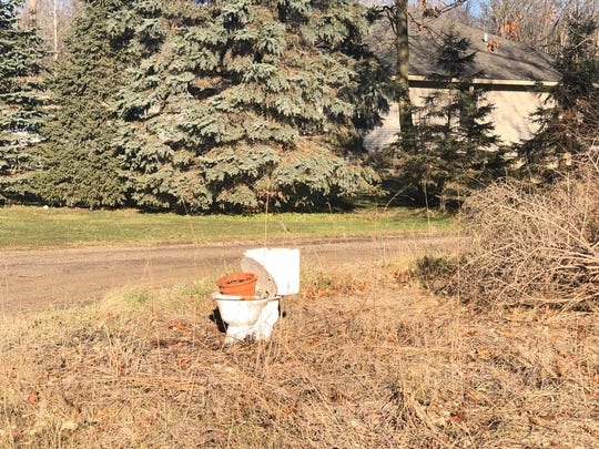 An old toilet off the road in New Boston, where the Sassins live.