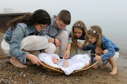Mia, Adam, Beth and Hannah Stromberg with their foster brother at Lighthouse Park beach in Port Huron. The baby arrived at their home on April 18, 2015 and this photo was taken a short while later.