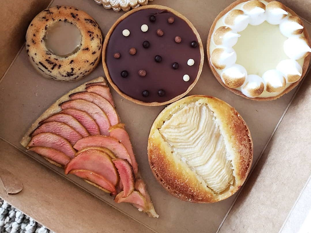 Warda Patisserie recently set up shop inside Eastern Market's Trinosophes, serving gorgeous and elegant pastries. It's hard to pick a favorite, but the simple rustic tart (lower left) stands out.
