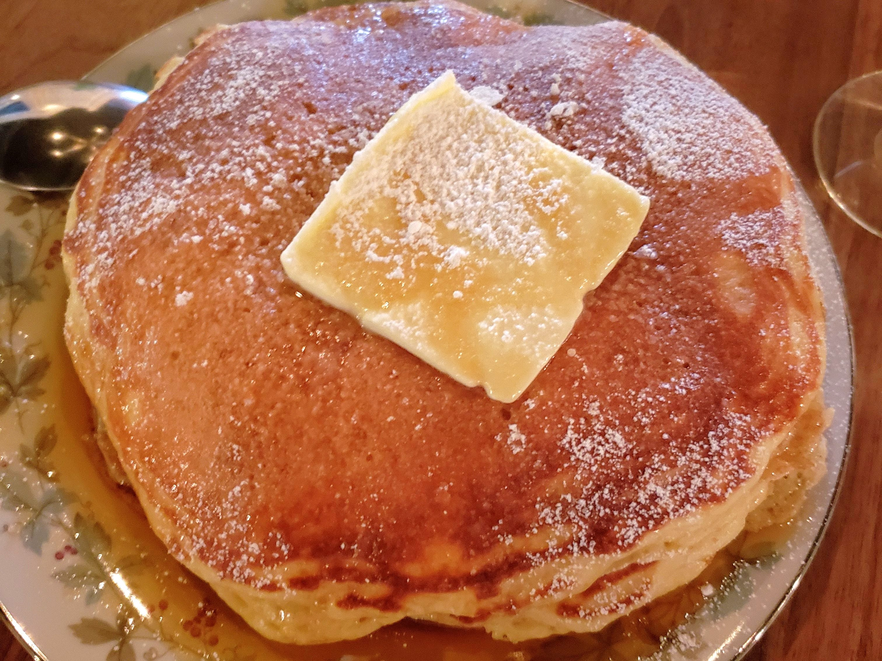 Extra fluffy, face-sized pancakes are served with smoked maple syrup during brunch at Lady of the House in Corktown.