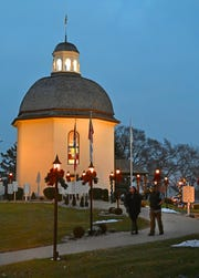 Tourists leave the Silent Night chapel after dusk at Bronner's Christmas Wonderland in Frankenmuth on Dec 12, 2018.