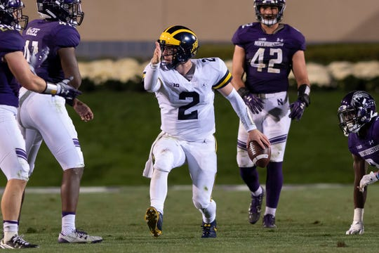 Shea Patterson signals after running for a first down in the fourth quarter against Northwestern.