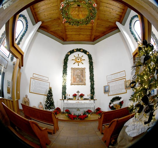The Silent Night chapel at Bronner's Christmas Wonderland in Frankenmuth has four small pews. The sanctuary area is usually closed off from the public by a glass partition.