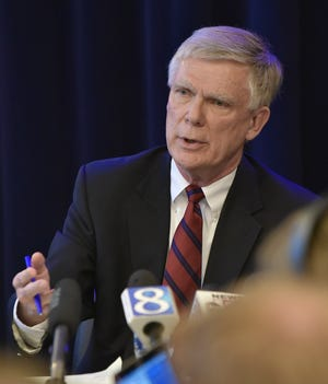 William Forsyth, special independent prosecutor investigating Michigan State University's handling of the Larry Nassar sex abuse scandal, addresses the media  about the  investigation at the G. Mennen Williams building in Lansing, Friday.