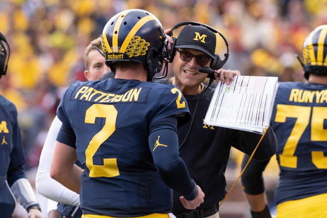 Jim Harbaugh with QB Shea Patterson.