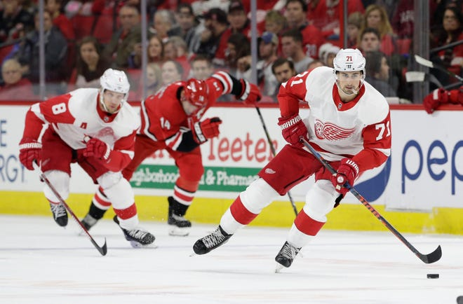 The Detroit Red Wings' Dylan Larkin skates against the Carolina Hurricanes during the first period Thursday night.