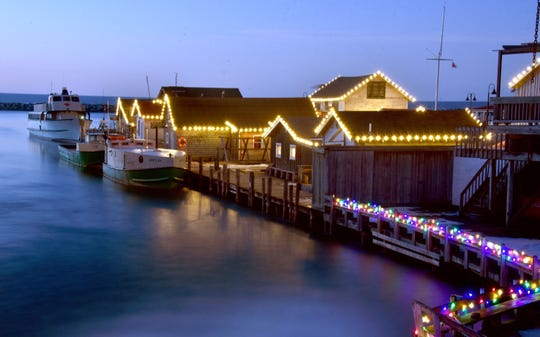 Leland's Fishtown sparkles with hundreds of lights lining the rooftops of the shanties.