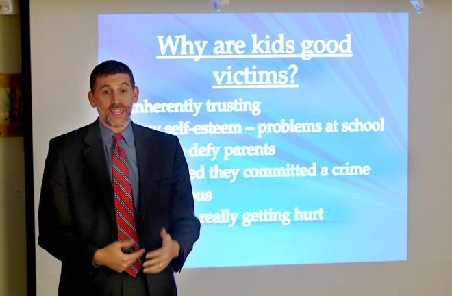 """Assistant United States Attorney Matthew Roth holds a talk on """"Sexting and Human Trafficking"""" at the Huntington Woods Public Library in Huntington Woods, Michigan on December 13, 2018."""