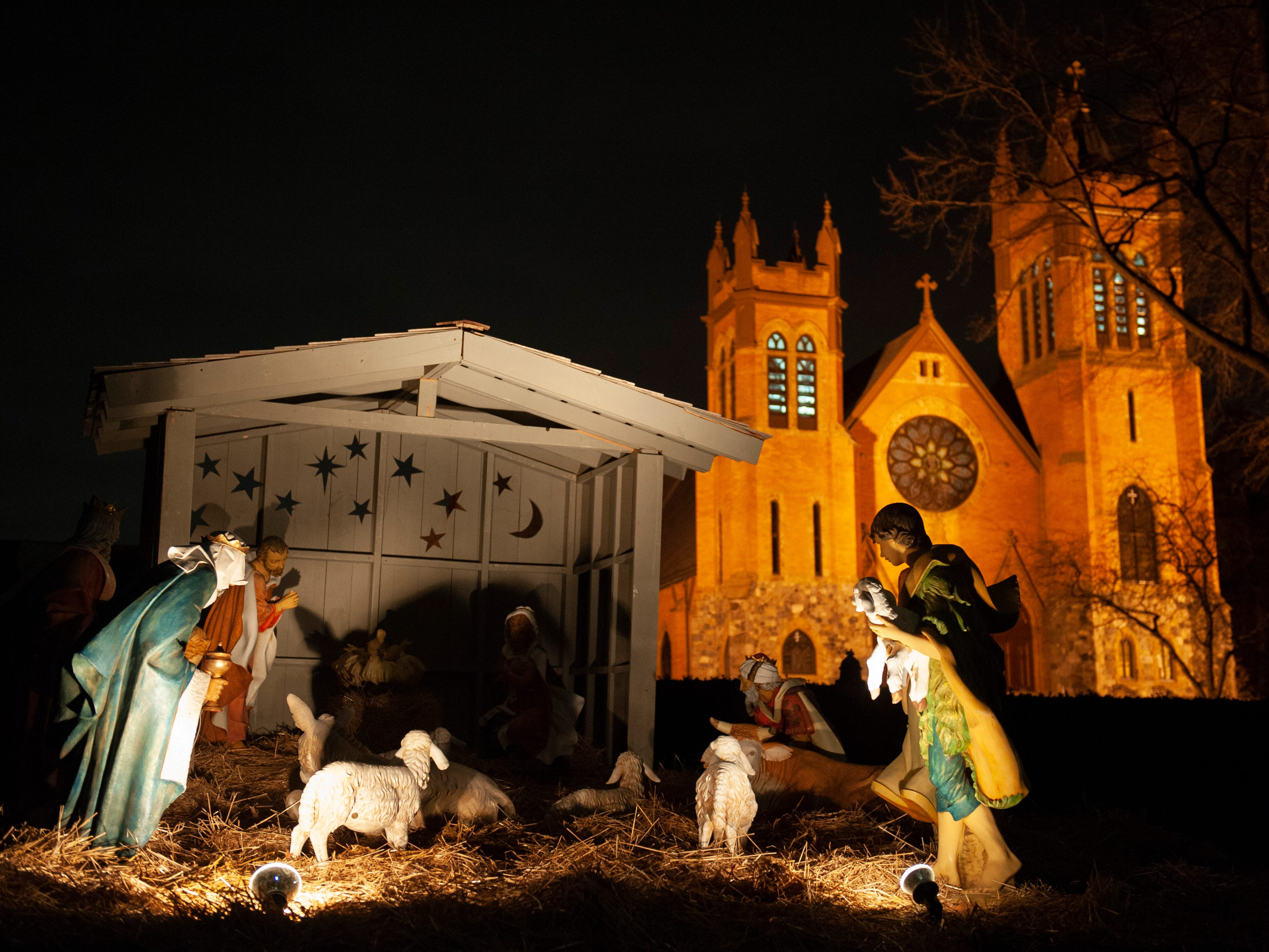 A nativity scene depicts the birth of Jesus Christ in the lawn in front of St. Paul Catholic Church along Lake Shore Drive in Grosse Pointe on Tuesday, December 17, 2018.