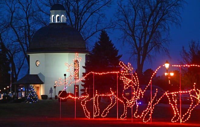 LED reindeer graze near the Silent Night chapel at Bronner's Christmas Wonderland in Frankenmuth .