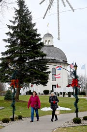 Tourists leave the Silent Night chapel at Bronner's Christmas Wonderland in Frankenmuth on Dec. 12.