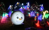 60,000 lights illuminate electrical engineer Kevin Nagy's holiday display in Waterford.