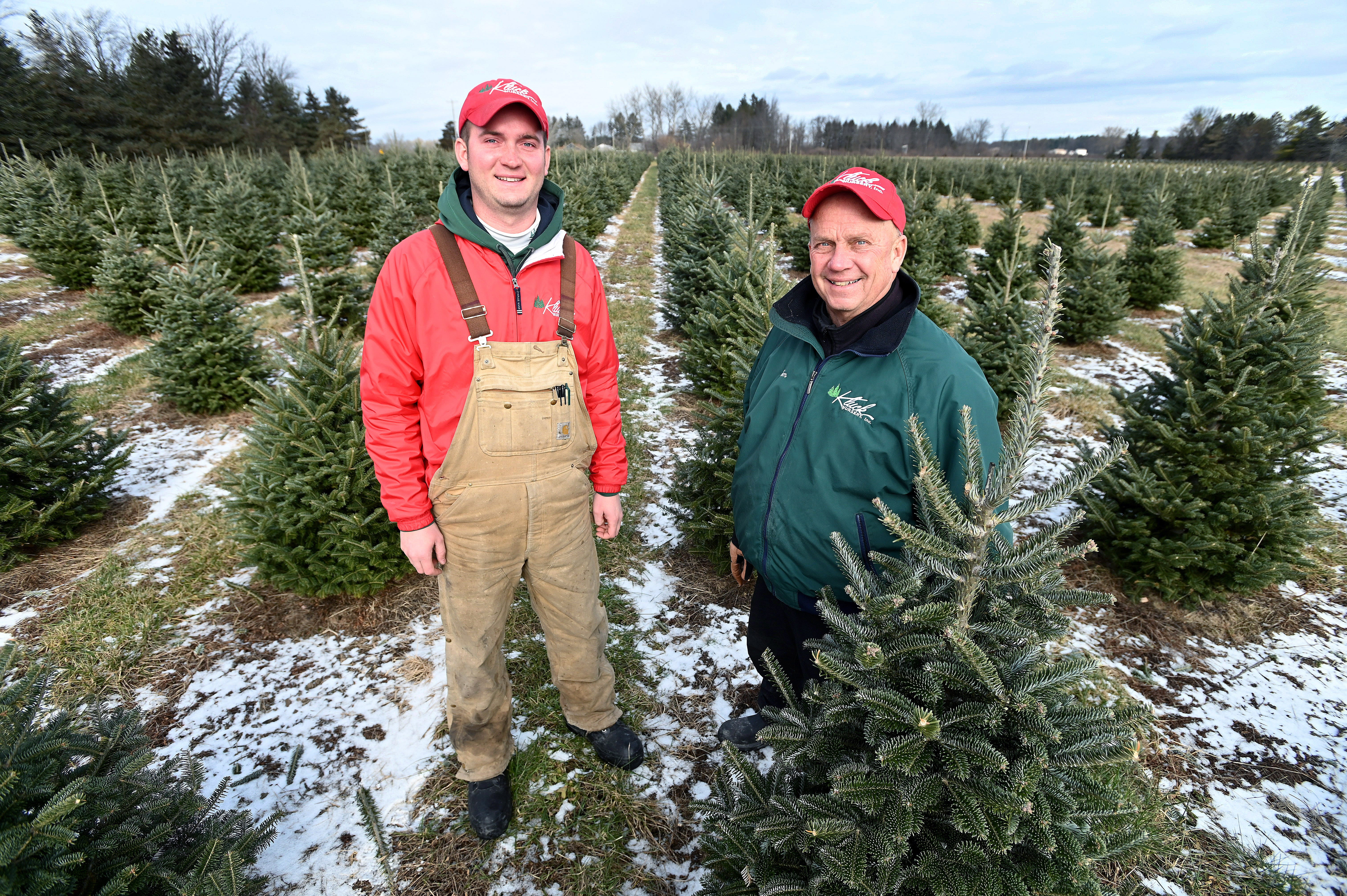 Father and son team Tom and Tyler Kluck have to look ahead, and make sure there are enough trees being grown for future harvests, at the Kluck family Christmas tree farm and nursery near Saginaw on Dec 7, 2019.