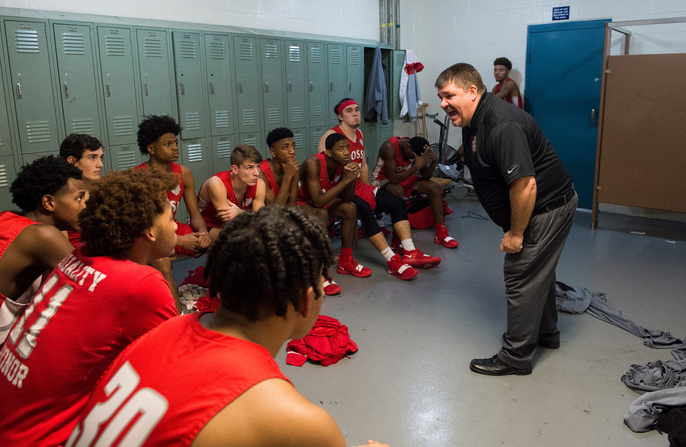 Bosse Head Coach Shane Burkhart energizes the varsity team in the locker room during halftime of the Bosse vs Memorial game Tuesday, Dec. 11, 2018.