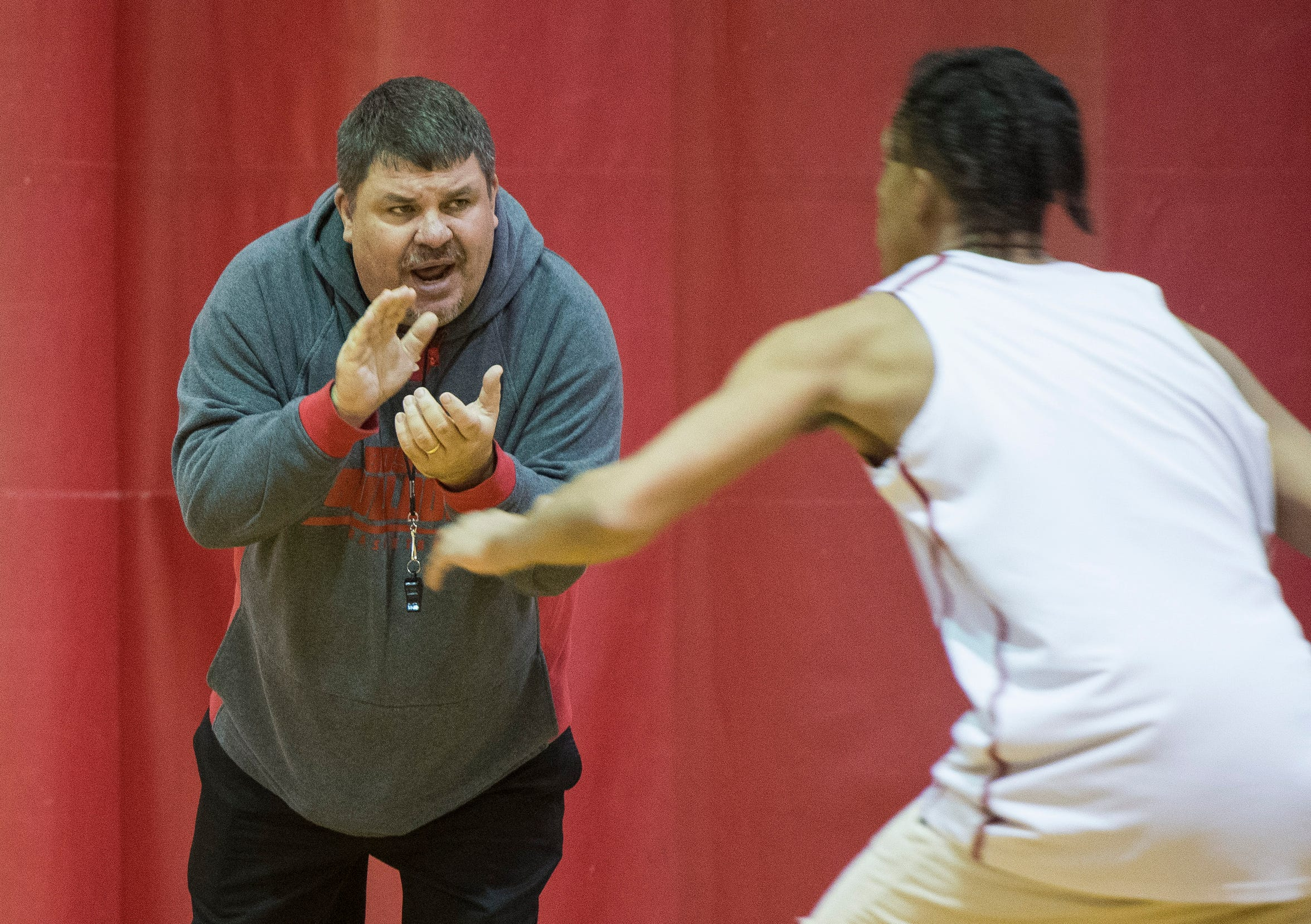 Bosse Head Coach Shane Burkhart energizes the team during practice Thursday, Dec. 13, 2018.