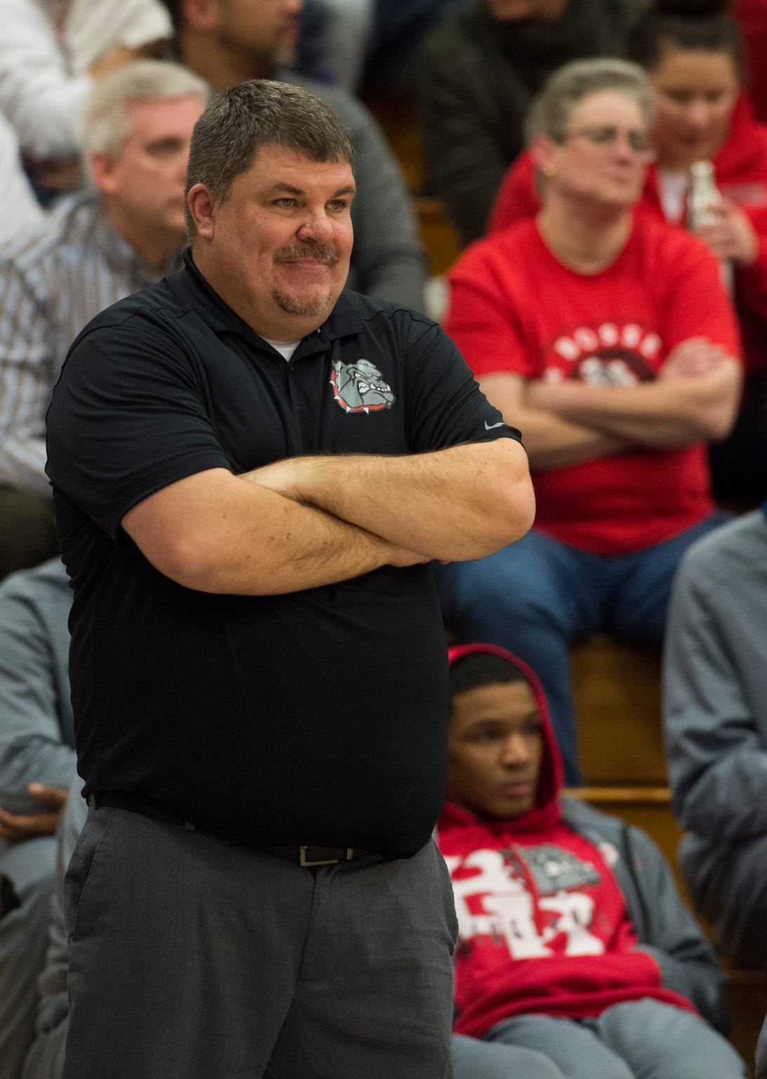 Bosse Head Coach Shane Burkhart smiles on the sideline as the Bosse Bulldogs take on the Memorial Tigers Tuesday Dec. 11, 2018.