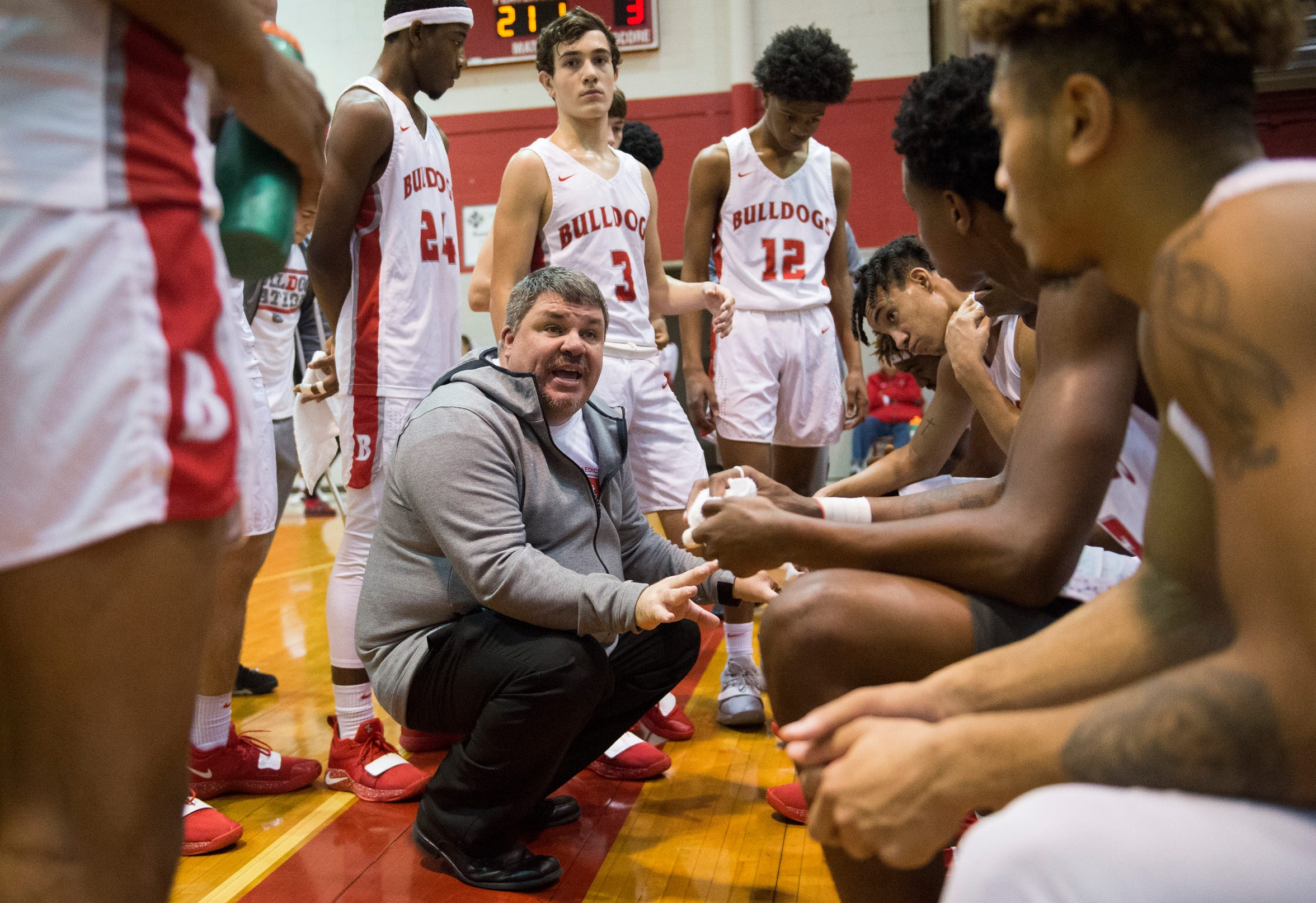 Bosse Head Coach Shane Burkhart directs players during a timeout in the Bosse vs Sanford game of the Bosse Classic Saturday, Dec. 15, 2018.