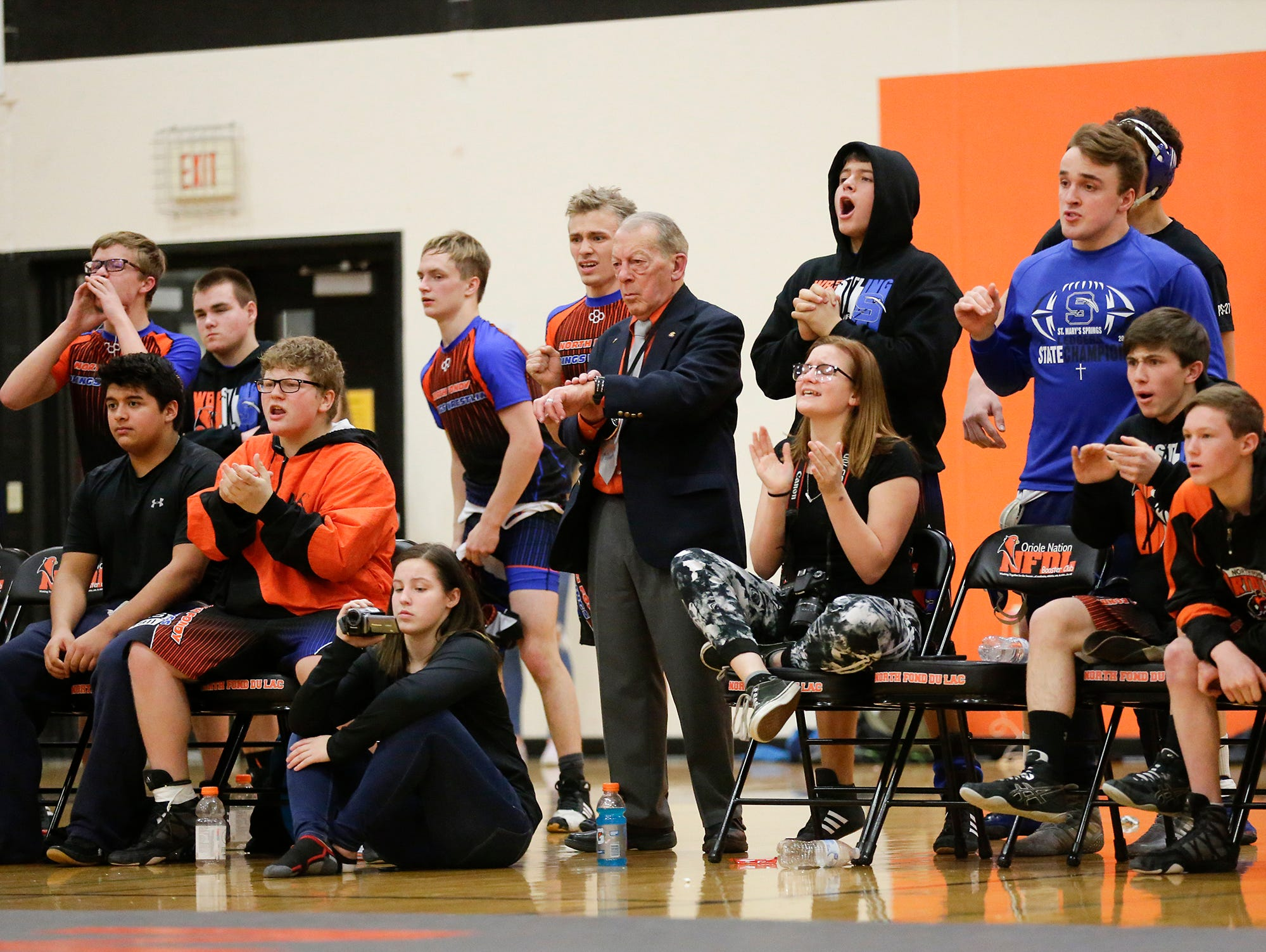 St. Mary's Springs Academy/North Fond du Lac High School wrestling coaches and players cheer on Carson Reitz as he wrestles against Lomira High School's Hunter Feucht during their 170 pound weight class match in North Fond du Lac. Reitz won the match by a pin and Springs/North Fond du Lac won the meet 48-28. Doug Raflik/USA TODAY NETWORK-Wisconsin