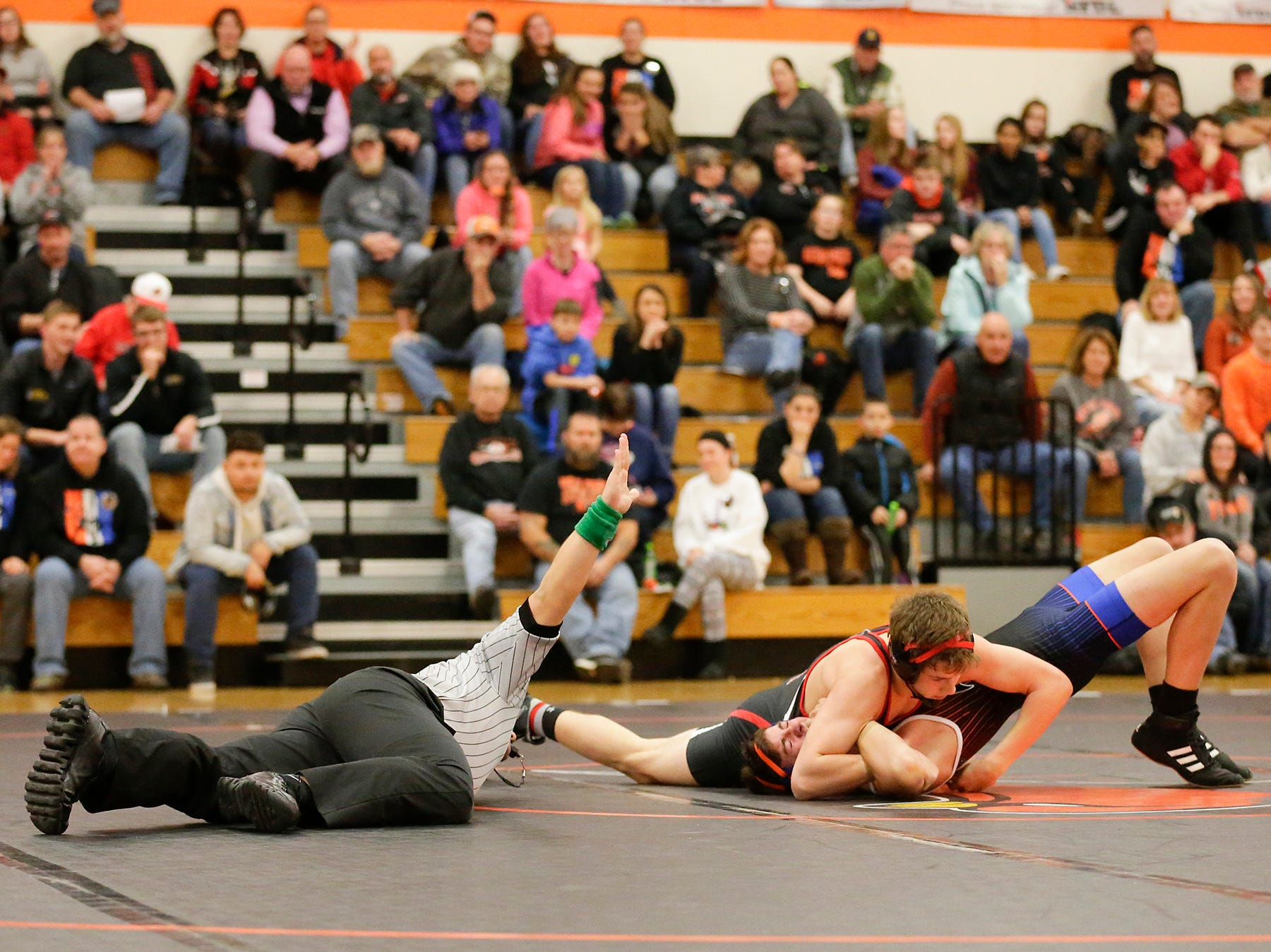 "St. Mary's Springs Academy/North Fond du Lac High School wrestling""s Jacob Hopp wrestles against Lomira High School's Adam Sauer during their match in North Fond du Lac. Sauer won the match by a pin and Springs/North Fond du Lac won the meet 48-28. Doug Raflik/USA TODAY NETWORK-Wisconsin"