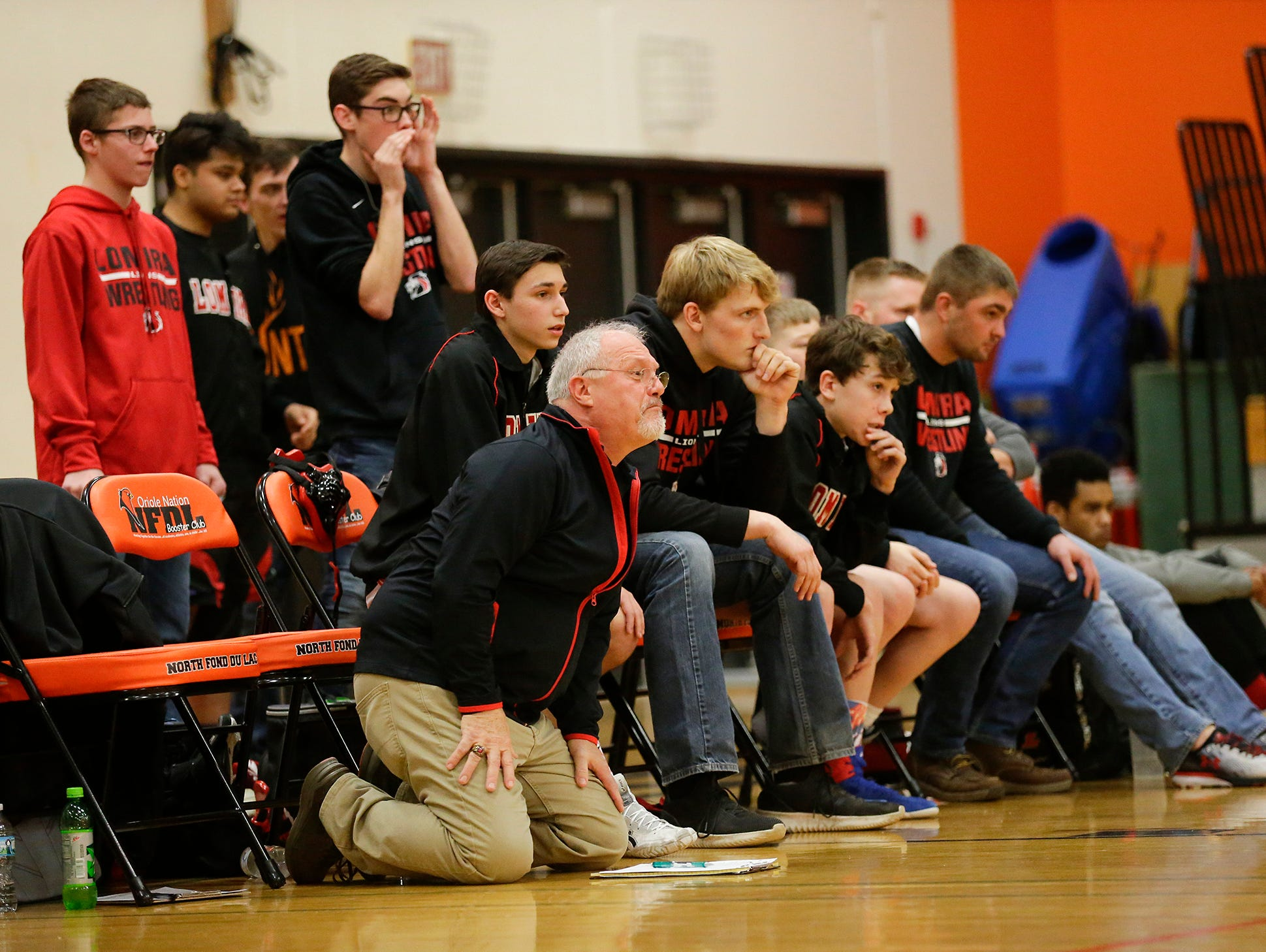 "Lomira High School coaches and wrestlers watch as St. Mary's Springs Academy/North Fond du Lac High School wrestling""s Carson Reitz wrestles against Lomira High School's Hunter Feucht during their 170 pound weight class match in North Fond du Lac. Reitz won the match by a pin and Springs/North Fond du Lac won the meet 48-28. Doug Raflik/USA TODAY NETWORK-Wisconsin"