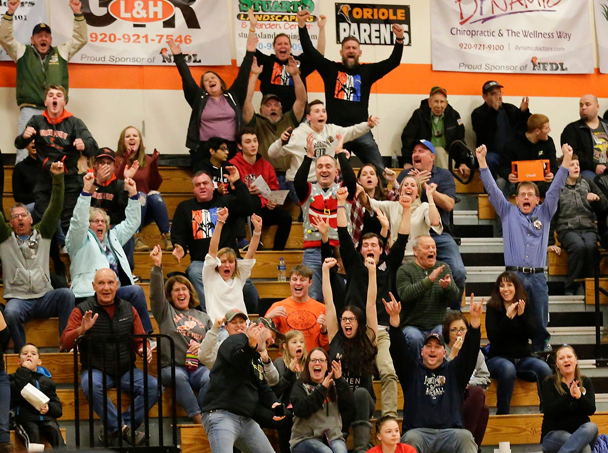 St. Mary's Springs Academy/North Fond du Lac High School wrestling fans cheer as Carson Reitz pins Lomira High School's Hunter Feucht during their 170 pound weight class match in North Fond du Lac. Reitz won the match by a pin and Springs/North Fond du Lac won the meet 48-28. Doug Raflik/USA TODAY NETWORK-Wisconsin