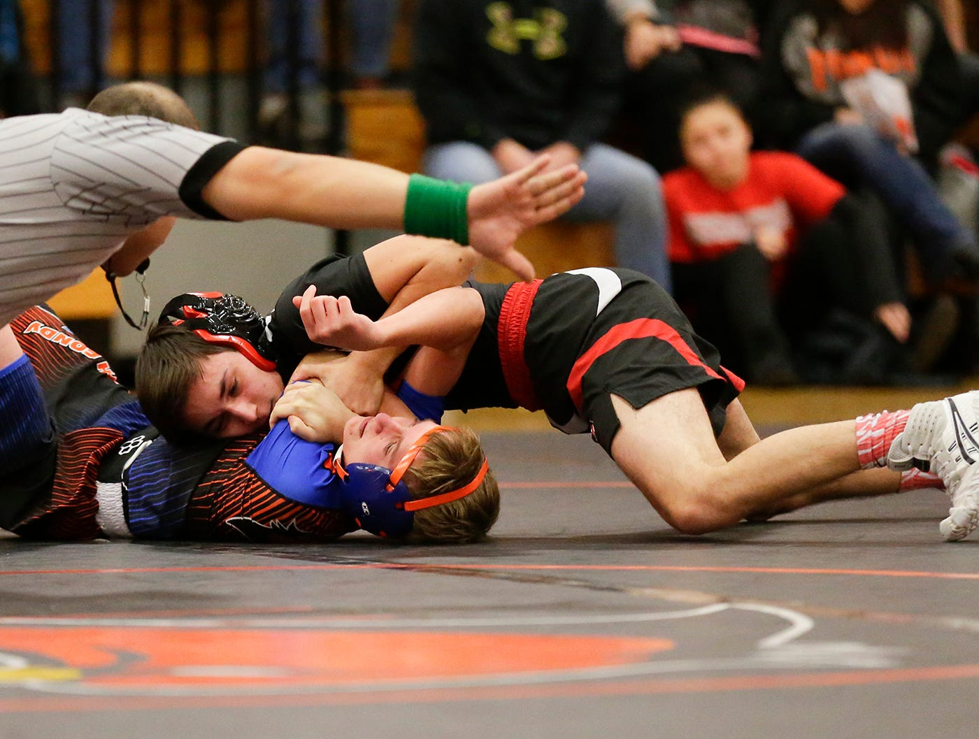 St. Mary's Springs Academy/North Fond du Lac High School wrestling's Zach Williams-Romero wrestles against Lomira High School's Carlos Lopez during their 106 pound weight class match in North Fond du Lac. Lopez won the match by a pin and Springs/North Fond du Lac won the meet 48-28. Doug Raflik/USA TODAY NETWORK-Wisconsin