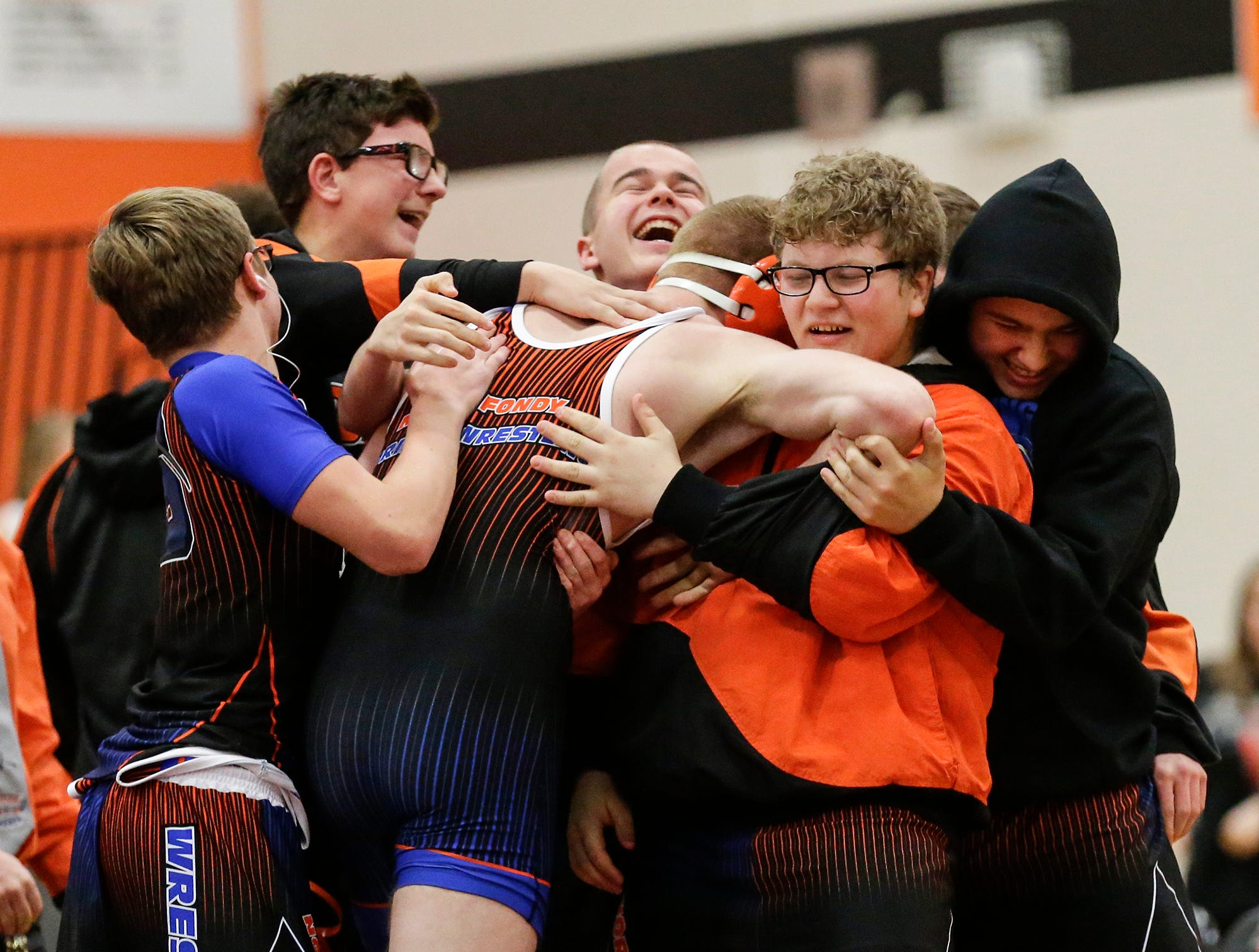 St. Mary's Springs Academy/North Fond du Lac High School wrestlers congratulate Carson Reitz after he pinned Lomira High School's Hunter Feucht during their 170 pound weight class match in North Fond du Lac. Reitz won the match by a pin and Springs/North Fond du Lac won the meet 48-28. Doug Raflik/USA TODAY NETWORK-Wisconsin