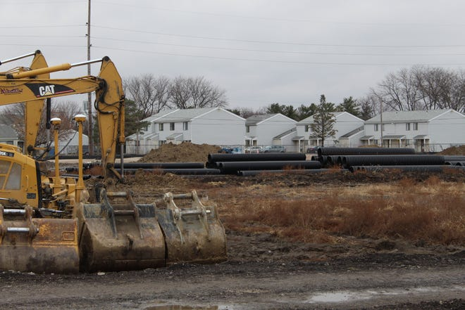 Work continues at the new Kroger construction site on Cedar Street, as heavy equipment, piping and mounds of dirt could be seen at the location Friday. Kroger expects to open the new store some time late next year.