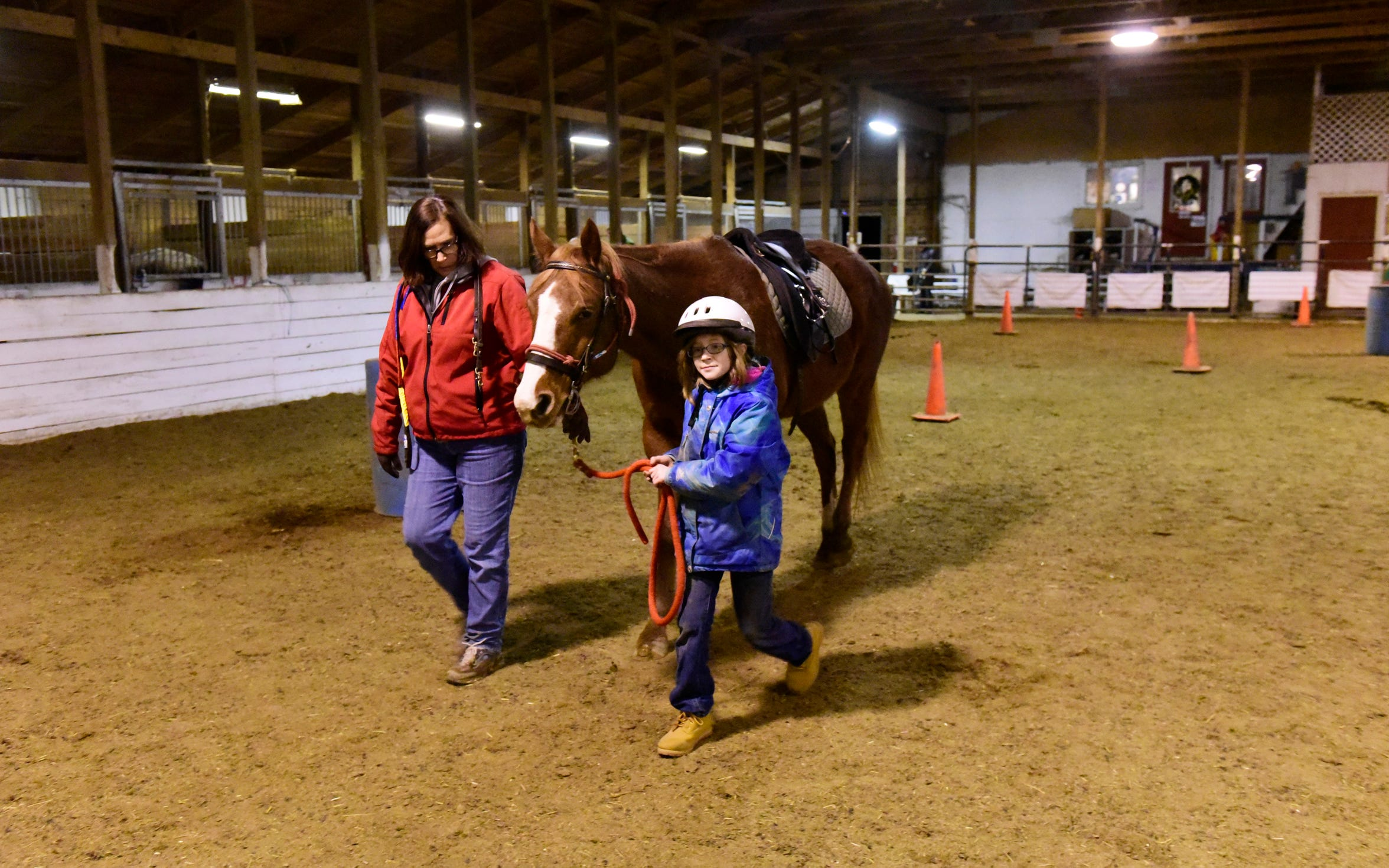 Charlie Hilton, 10, of Port Clinton leads Rudy, a 15-year-old gelding quarter horse with volunteer leader Sue Hoffman. Her father is serving in the U.S. Army and had been deployed overseas for the past year.