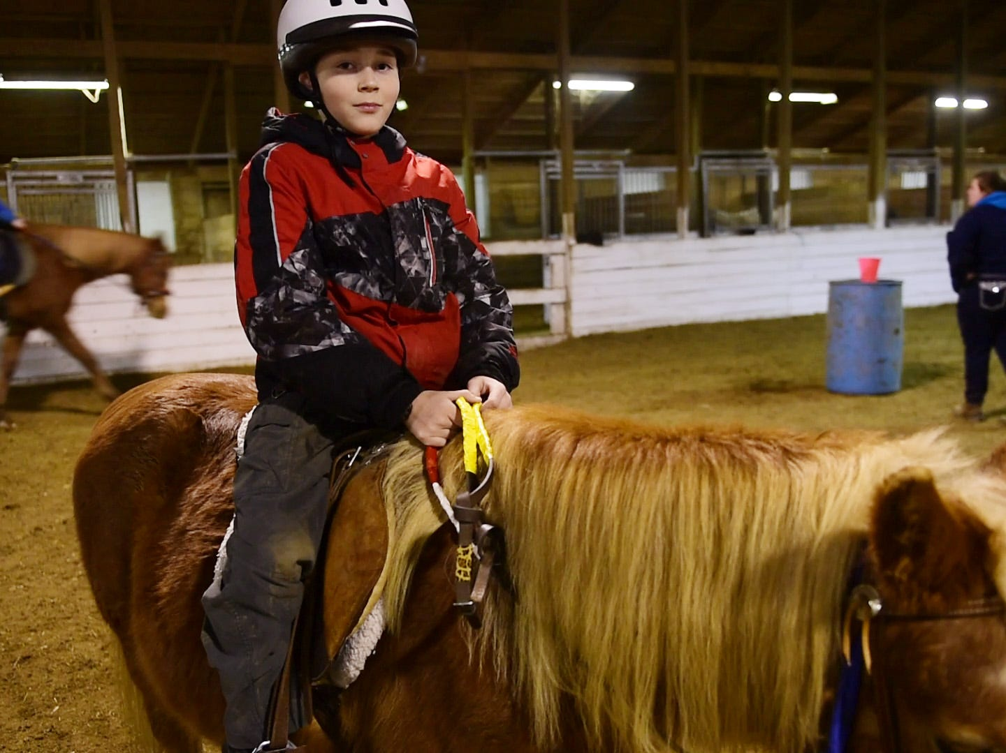 Joey Hilton, 11, of Port Clinton rides Sprite, a 23-year-old gelding Haflinger/Wesh pony. He said being on top of a horse gave him a sense of control. His father is serving in the U.S. Army and had been deployed overseas for the past year.