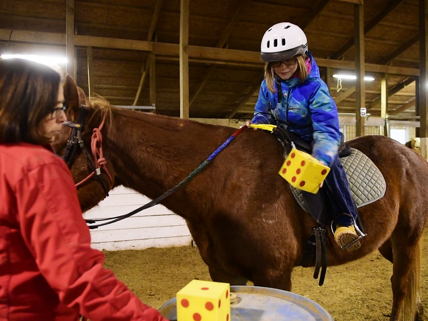 Charlie Hilton, 10, of Port Clinton plays a game to work on coordination during her lesson with volunteer leader Sue Hoffman.