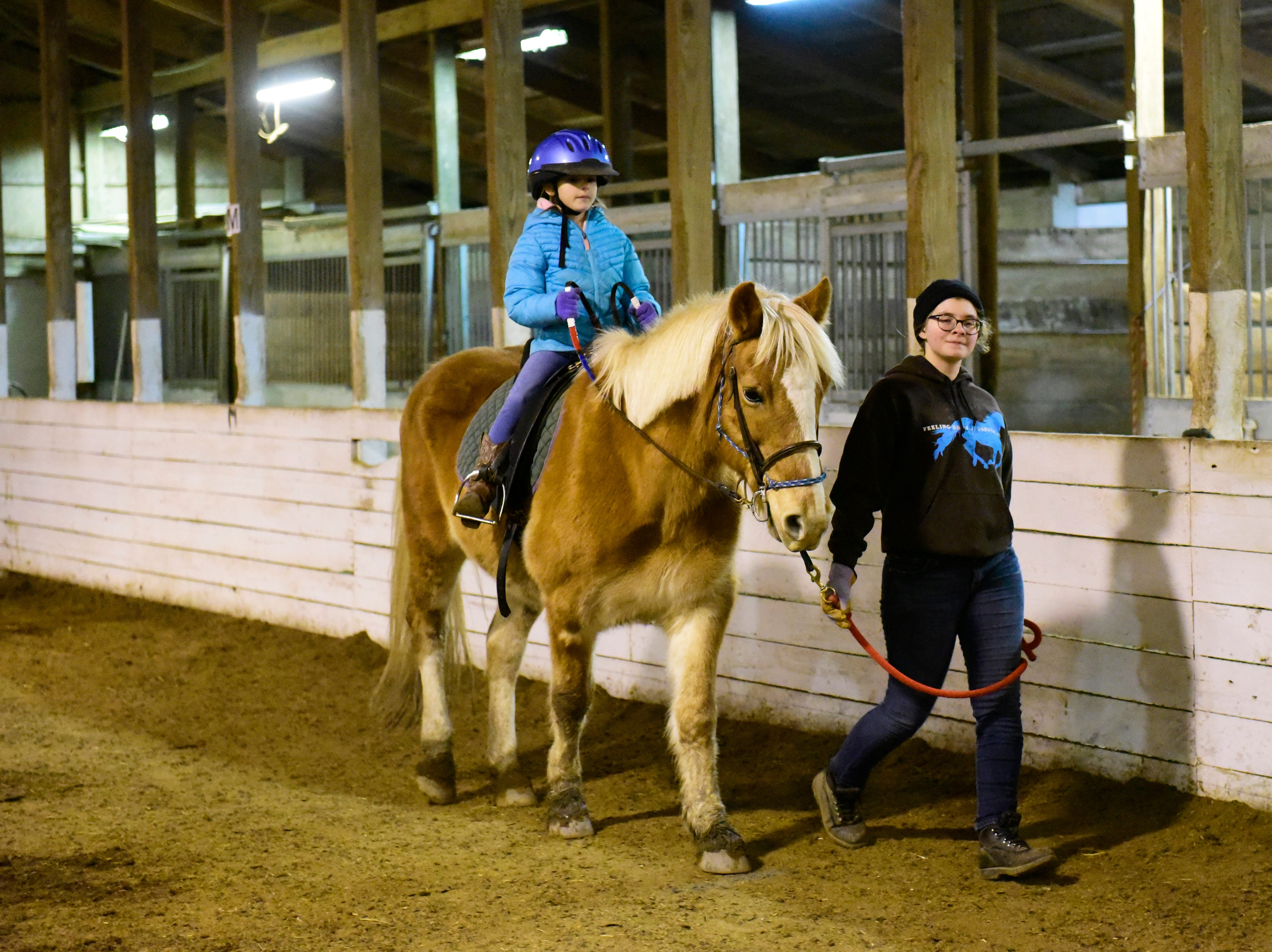 Aubrey Messa, 8, of Oak Harbor rides Gracie, a 13 year old Haflinger mare, with help from volunteer leader Ava Van Ness.