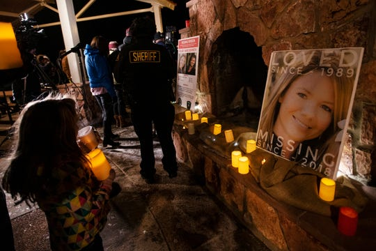 Community members hold a candlelight vigil for Kelsey Berreth under the gazebo of Memorial Park in Woodland Park, Colo., on Thursday, Dec. 13, 2018. Berreth was last seen on Thanksgiving Day, captured on surveillance video entering a grocery store with what appears to be her 1-year-old daughter in a baby carrier.  (Kelsey Brunner/The Gazette via AP)