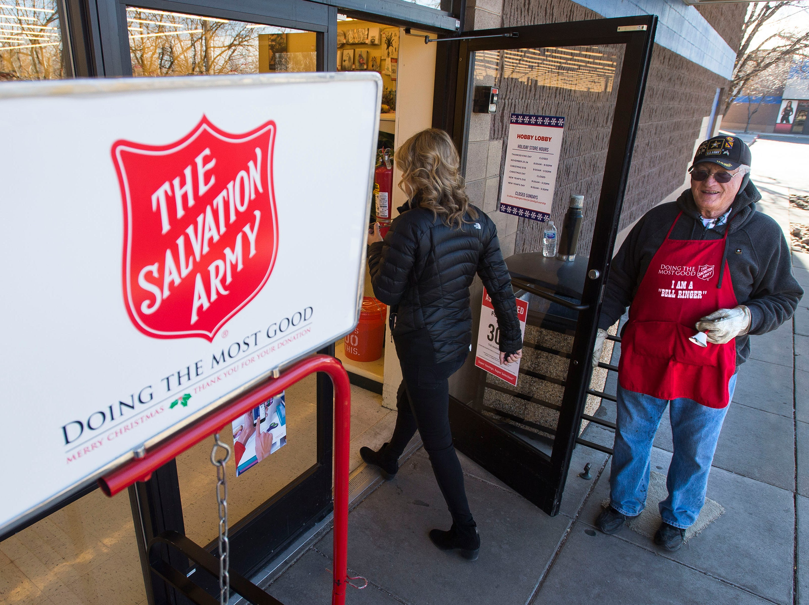 Salvation Army bell ringer Robert Thompson wishes a customer a merry Christmas as he hold the door open on Friday, Dec. 21, 2018, in front of the Hobby Lobby on South College Avenue in Fort Collins, Colo.