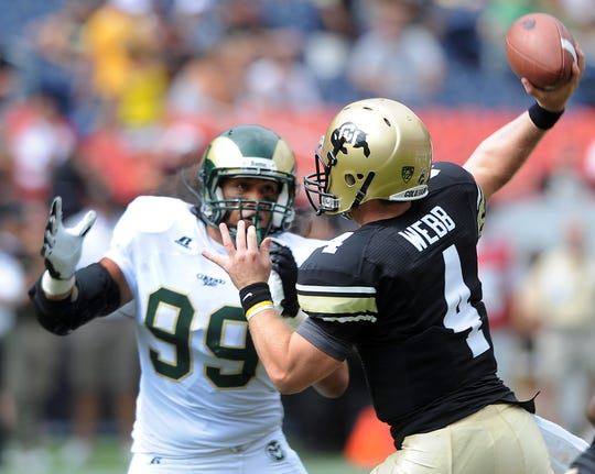 CSU defensive lineman Elisara Edwards pressures University of Colorado quarterback Jordan Webb during a Sept. 1, 2012, game at Sports Authority Field at Mile High in Denver.