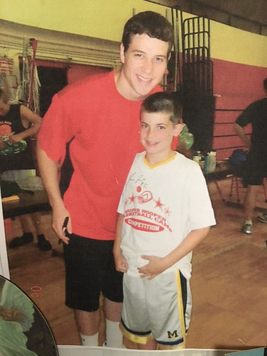 A young Joseph Girard III with Jimmer Fredette.
