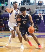 University High School's Vernon Carey Jr. drives to the basket against IMG's Armando Bacot, Jr. during Fridays game at Suncoast Credit Union Arena.