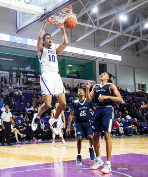 IMG Academy's Jeremiah Robinson-Earl dunks during a game against University High School on Friday. Robinson-Earl led all scorers in the win.