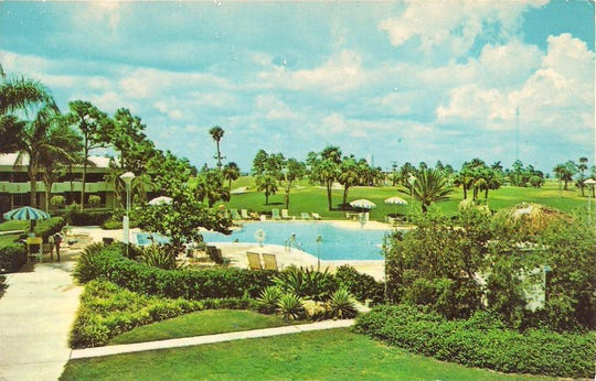 The swimming pool at the new country club is featured on this late 1960s postcard.